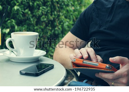 close up man's hands using tablet - stock photo