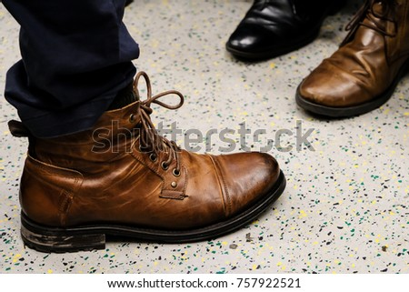 Close up Men Leather Boot with Blue Trouser