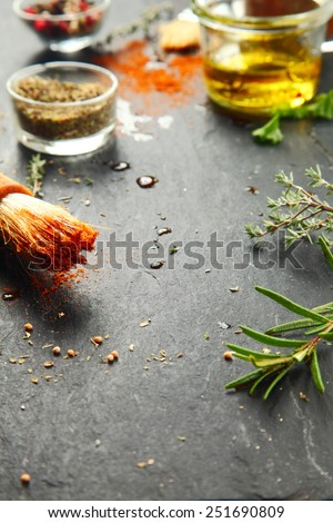 Close up Messy Black Kitchen Table with Fresh Herbs and Spices for Recipe. - stock photo