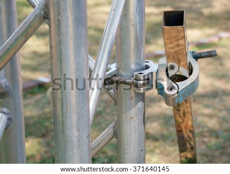 Close up metal scaffolding clamps.