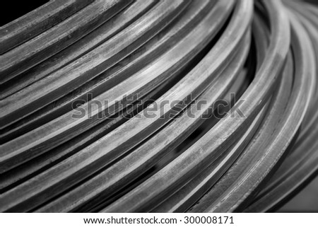Close up metallic wire coil for industrial background in black and white color - stock photo