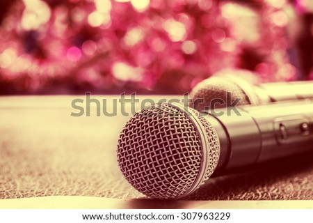 close up microphone on table.vintage filter color tone. - stock photo