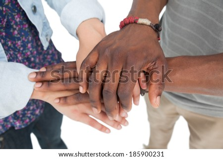 Close-up mid section of a couple with hands together over white background