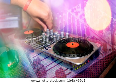 close-up mixing dj console collage in colorful disco night  - stock photo