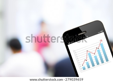close up  mobile phone with analyzing graph with business people background  - stock photo