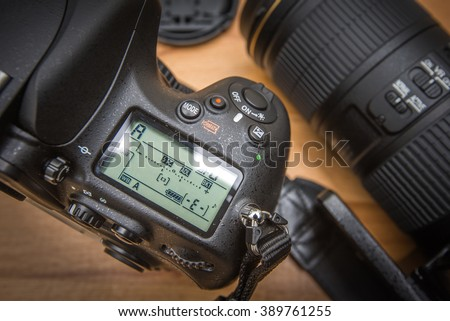 Close up  modern DSLR camera and fuctional