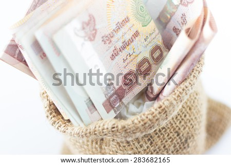 Close up money in the bag isolated on a white background - stock photo