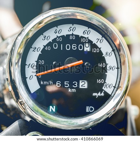 close-up motorcycle speedometer with chrome ring in vintage color - stock photo