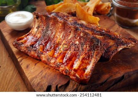 Close up Mouth Watering Juicy Grilled Pork Rib Meat on Top of Wooden Cutting Board - stock photo