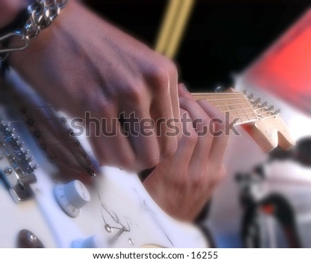 Close up musician playing electric guitar