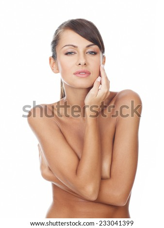 Close up Naked Sensual Young Woman Crossing Arms at her Chest Part with One Hand Touching the Face While Looking at the Camera. Isolated on White Background. - stock photo