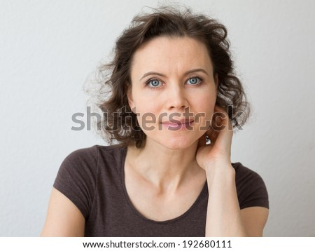 Close-up natural portrait of woman 30-40 years old - stock photo