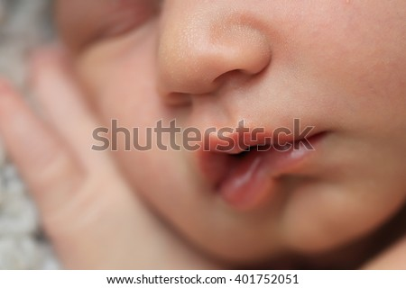 Close-up newborn baby face and lips  - stock photo