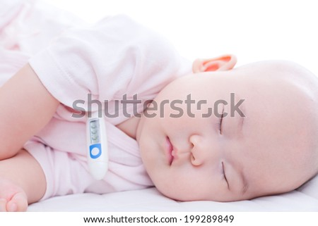 Close-up newborn baby sleeping in bed with digital mercury thermometer - stock photo