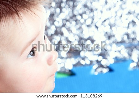 Close-up newborn with uncertain view with blurred background - stock photo