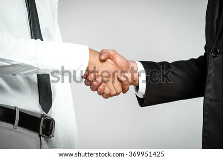 Close up nice photo of young businessmen. Businessmen shaking hands