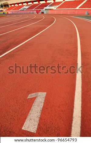 Close-up Number One on race track - stock photo