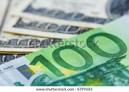 Close-up of a $100 and 100 euro banknotes - stock photo