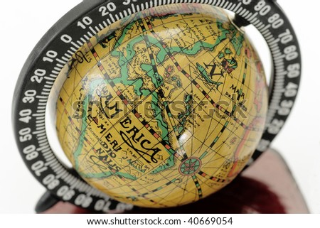 Close-up of a antique globe over white background - stock photo