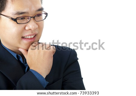 Close-up of a Asian businessman thinking. - stock photo