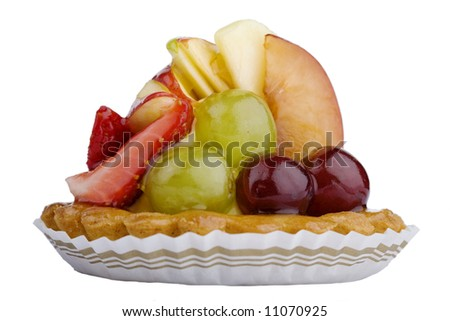 Close-up of a baked fruit tart in paper cup, isolated against white background (with clipping path) - stock photo