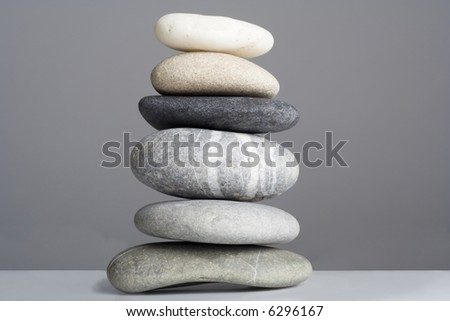 Close up of a balanced tower of stones. - stock photo