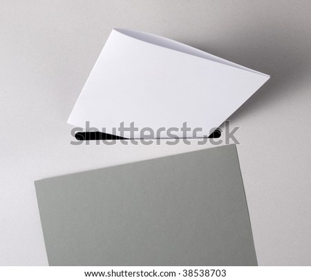 Close up of a ballot box with a white ballot-paper - stock photo