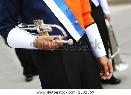 Close-up of a band member holding a trumpet.