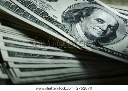 Close-up of a $100 banknotes - stock photo