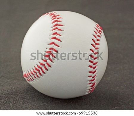 Close up of a baseball over black background