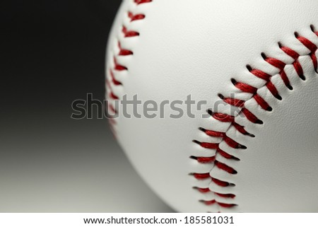 Close up of a baseball stitching and texture with a fading background. Sports concept - stock photo