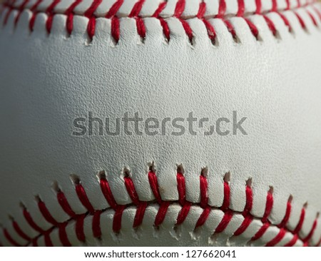 Close up of a baseball threads with room for copy