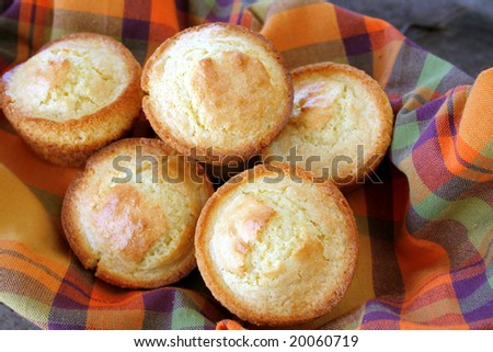Close up of a basket full of cornbread muffins. - stock photo