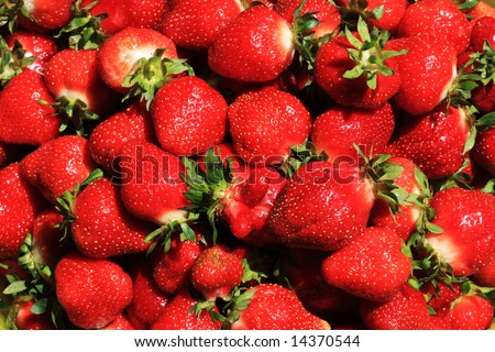Close up of a basket full of fresh red strawberries - stock photo