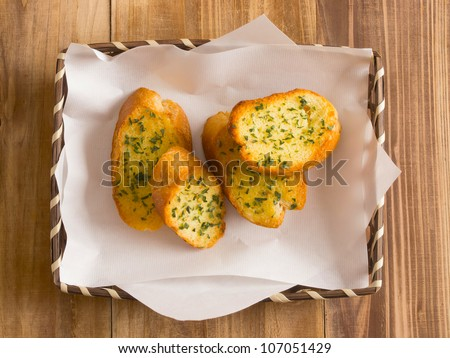 close up of a basket of garlic bread - stock photo