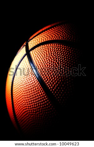 close-up of a basketball against a dark background vertical - stock photo