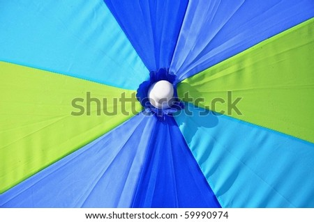 close up of a beach umbrella useful as a background pattern - stock photo