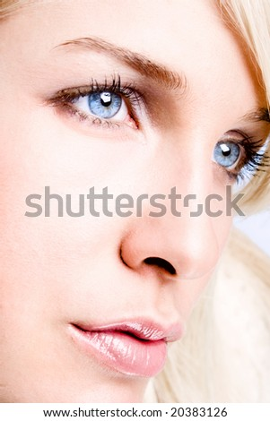 close up of a beautiful blue eyes woman - stock photo