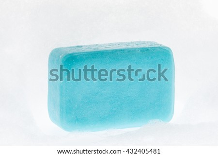 close up of a beautiful blue soap with foam on white background - stock photo