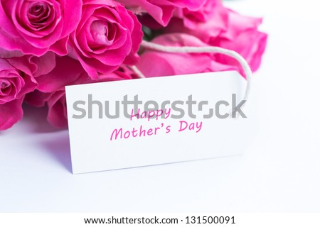 Close up of a beautiful bouquet of roses with a happy mothers day card - stock photo