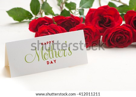 Close up of a beautiful bouquet of roses with a happy mothers day card