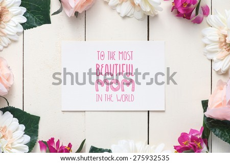 Close up of a beautiful bouquet of roses with a happy mothers day card. Mother's Day concept - stock photo