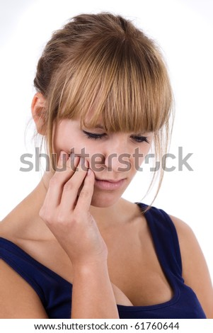 Close-up of a beautiful brunette woman with a toothache. Isolated on white background. - stock photo