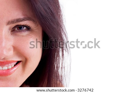 Close-up of a beautiful brunette woman with brown hair smiling. - stock photo