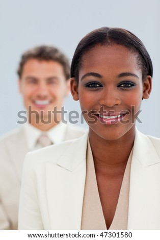 Close-up of a beautiful businesswoman and her colleague standing - stock photo