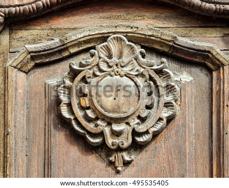 Close up of a beautiful carved pattern on an antique wooden door panel