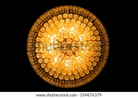 close up of a beautiful crystal chandelier isolated on black - stock photo