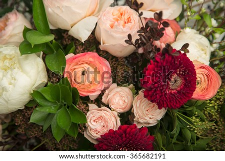 Close-up of a beautiful flower arrangement with peonies, roses and other flowers - stock photo