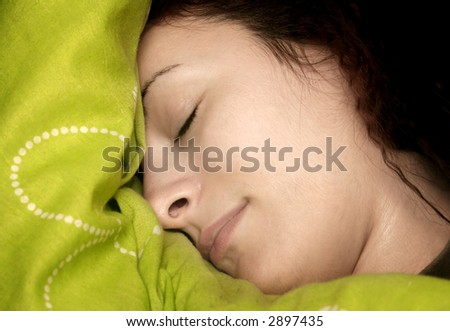 Close-up of a beautiful girl face - sleeping - stock photo