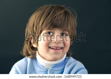 Close-up of a beautiful kid smiling - stock photo